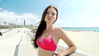Sasha Rose in a stunning red bikini poses outdoor