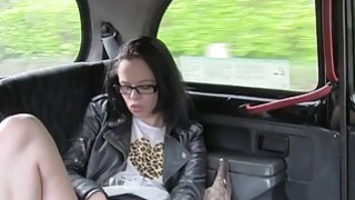 Brunette with glasses gags in fake taxi in public