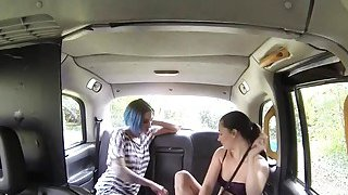 Lesbians trying sex toys in fake taxi