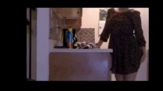Housewife Arina masturbates in the kitchen