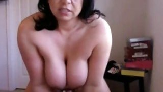 Big tits brunette milf rides her dildo on webcam