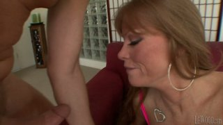 Mature busty whore Darla Crane gives titjob to Mark Wood