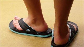 Light skin ebony feet in adidas sandals (My classmate)